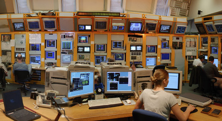 Operators in the Main Control Room work around the clock to run the collider