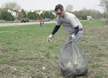 A volunteer at a past cleanup