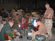 Danielle Peterson playing guitar while stationed in Iraq