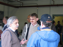 Milorad Popovic (left) talking to Steve Geer and Alan Bross