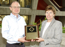 Mike Witherell (left) and Jane Monhart received the award on behalf of Fermilab.