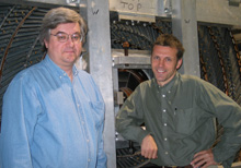 Gerry Bauer (left) of MIT works on the analysis of exotic states and the hardware for the time of flight. Christoph Paus, also of MIT, is the group leader for the MIT group at CDF and does analysis on B-mixing.